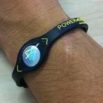 Power Balance bracelet on wrist