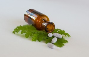 Image of pills on a herbal leaf