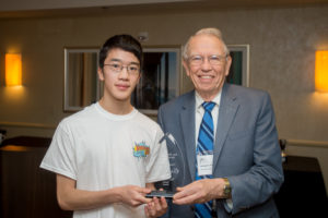 Yuji Okitani receives an award from George Andrews, former president of the American Mathematical Society